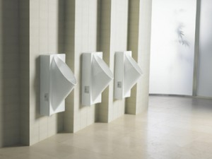 Image of three waterless urinals in GBB Blog on flushless urinals